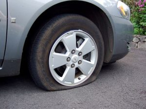 Picture of a flat tire.